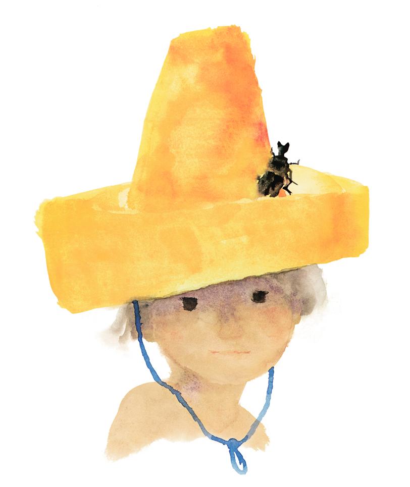 帽子にかぶと虫をのせた少年